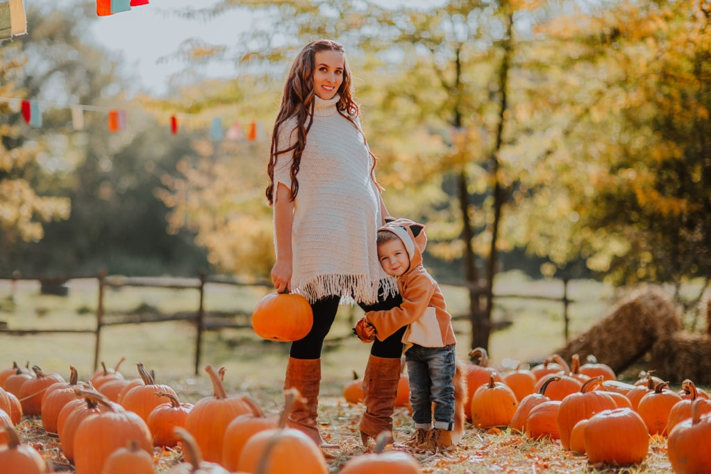 Pregnant woman at pumpkin patch Healthy Mama Brand